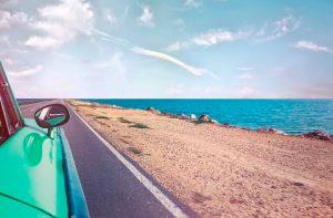 Car beach and sea