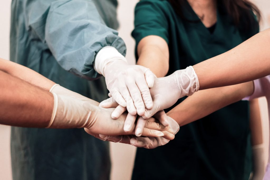 a group of healthcare professionals wearing gloves