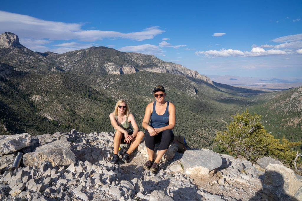2 women sitting at the top of mt. charleston in las vegas
