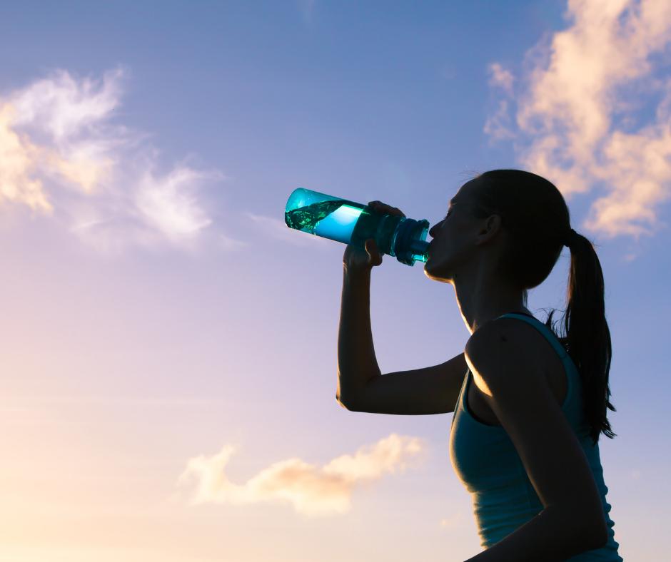 a women drinking a bottle of water